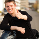 Motorcycle rider with a thumb-up